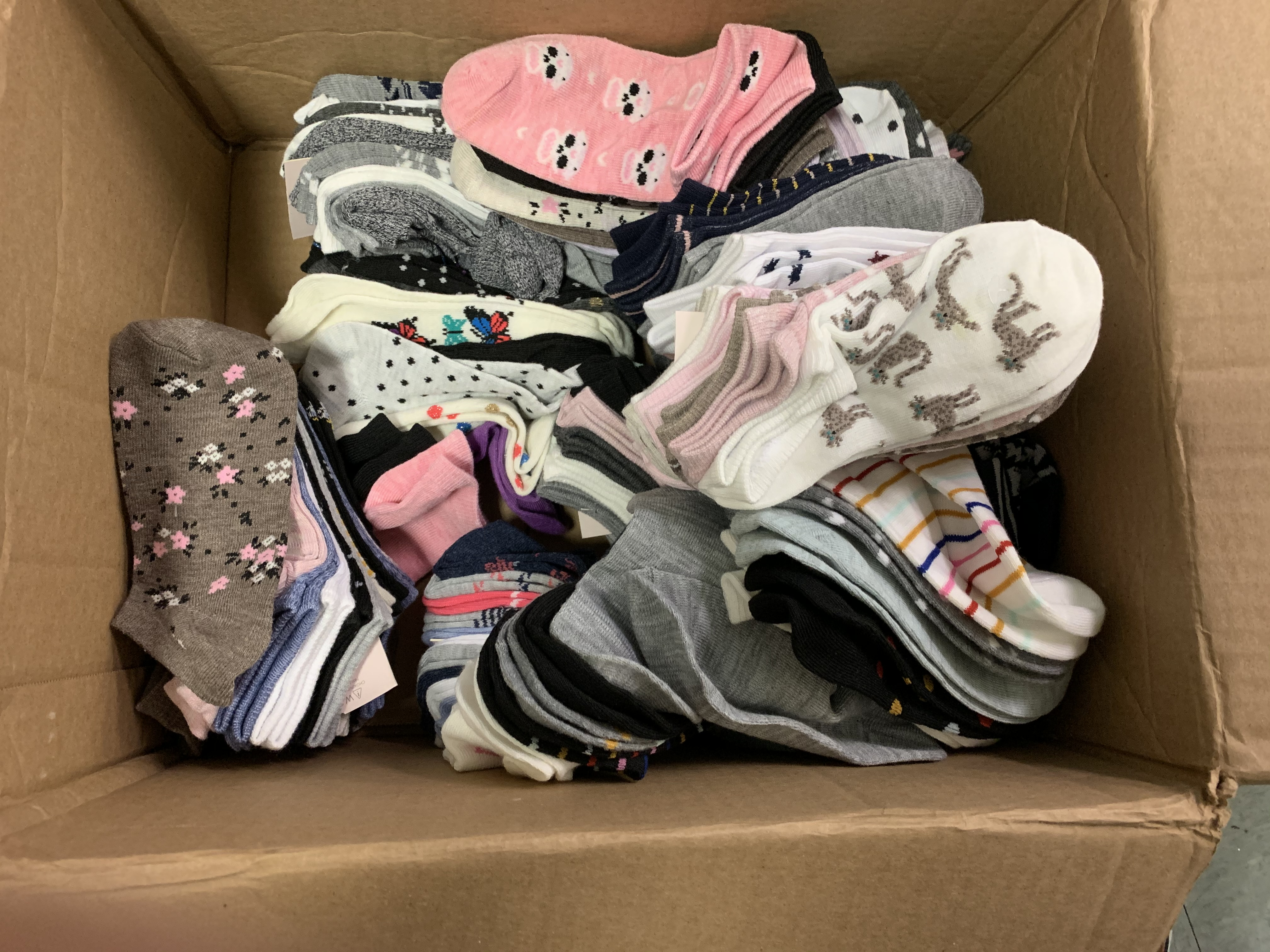 box of socks donated to Children's Aid NYC